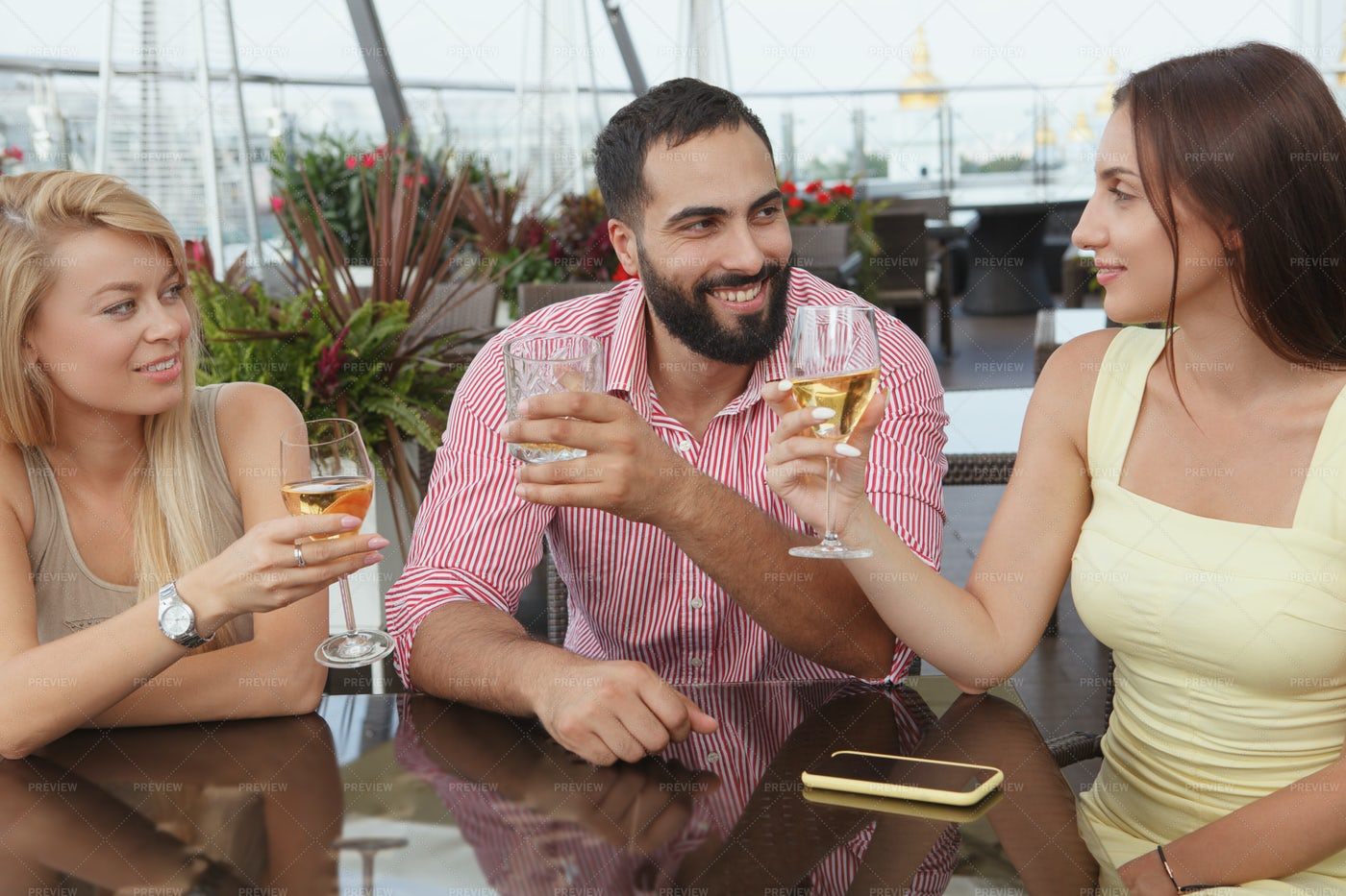 Friends Drinking On The Rooftop: Stock Photos