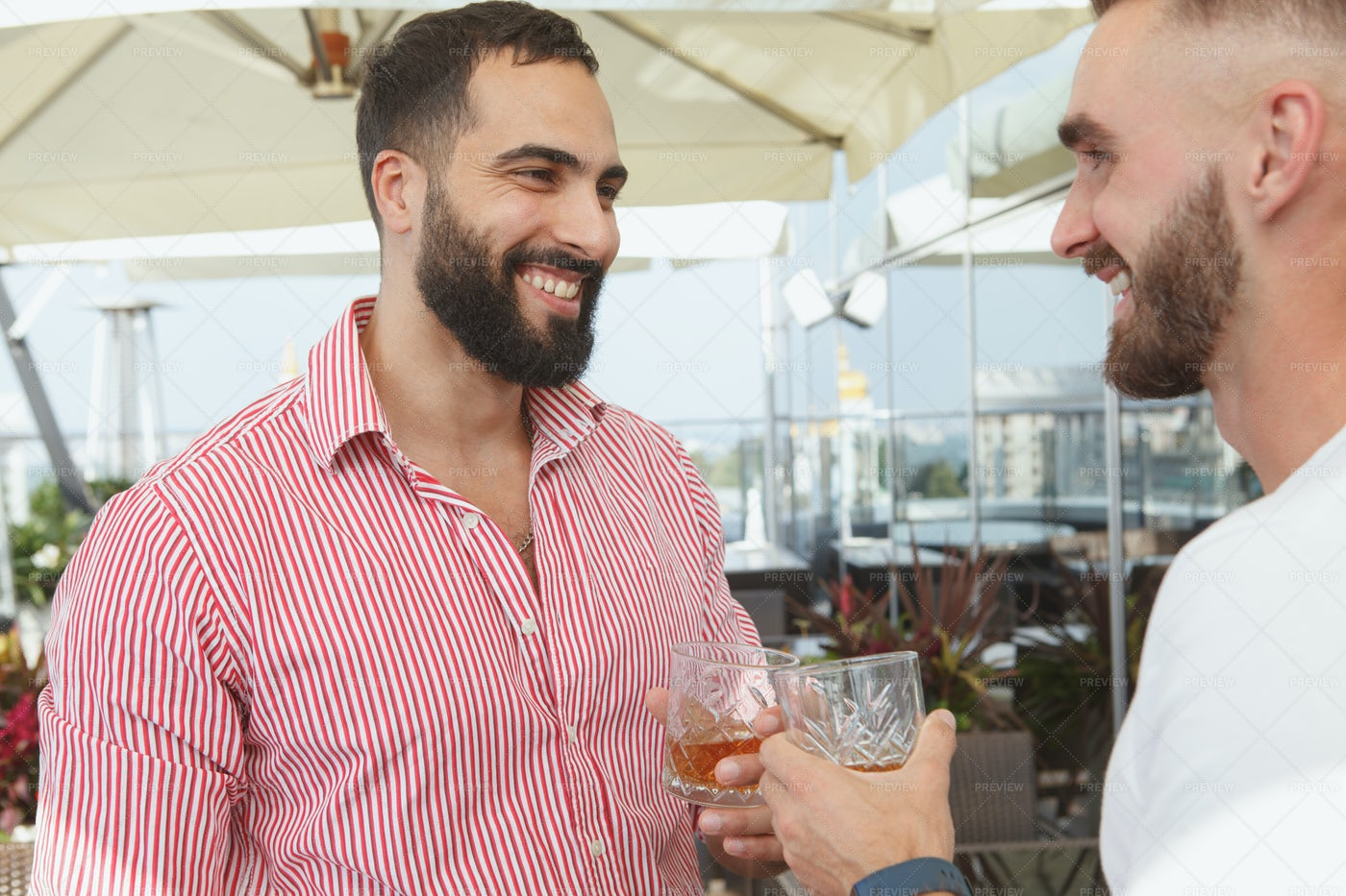 Man Having Drinks With His Friend: Stock Photos