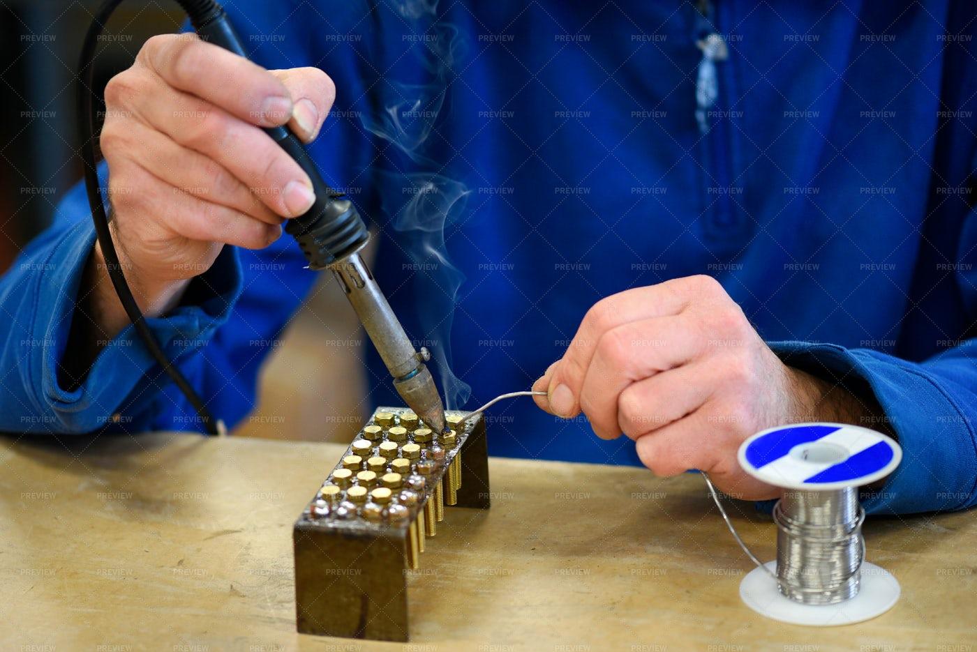 Worker Soldering Metal Parts: Stock Photos