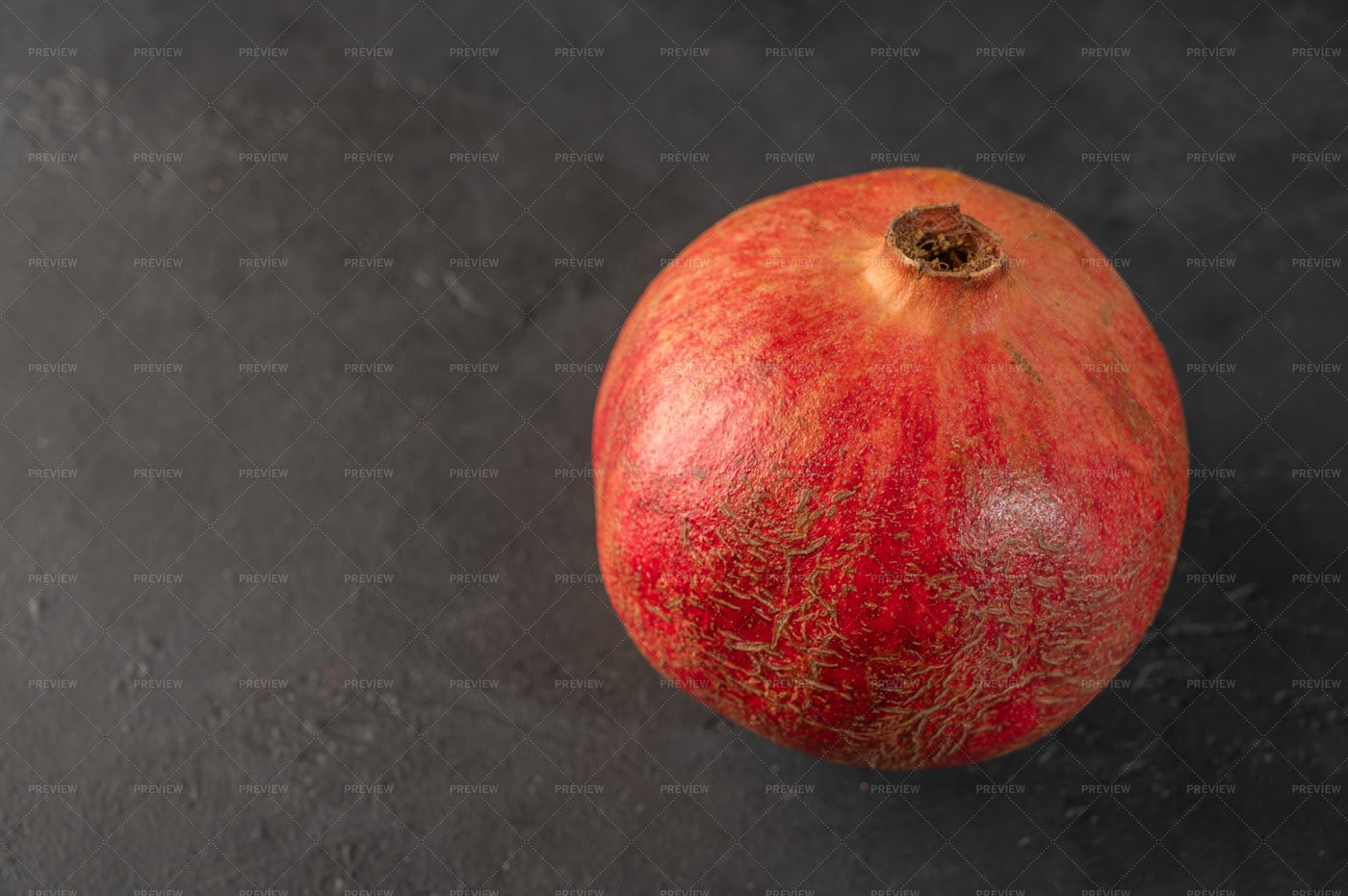 Pomegranate Against Back: Stock Photos