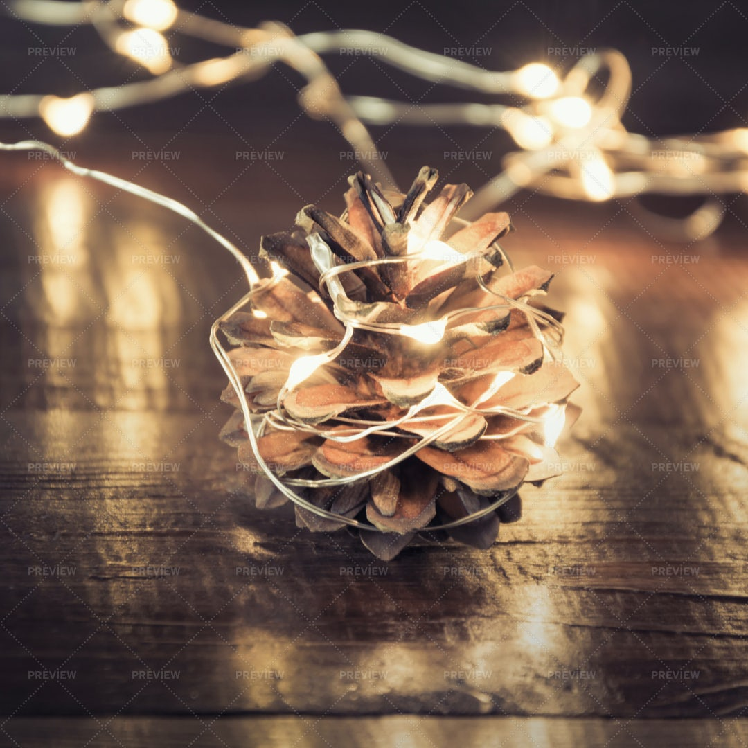 Pine Cone With Garland: Stock Photos