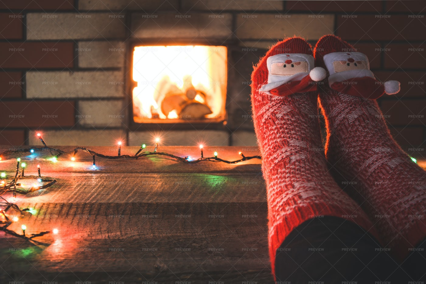 Feet In Red Christmas Socks: Stock Photos