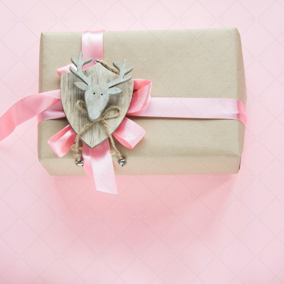 Christmas Gift With Pink Ribbon: Stock Photos