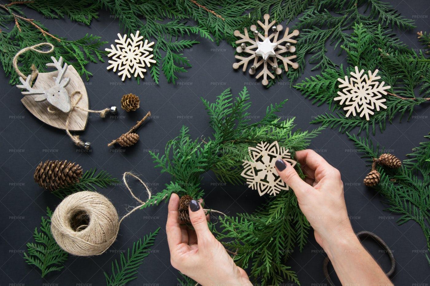 Decorating A Christmas Wreath: Stock Photos