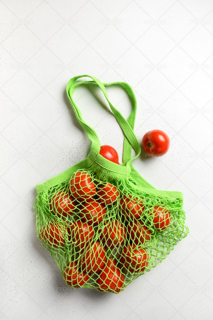 Mesh Bag With Tomatoes: Stock Photos
