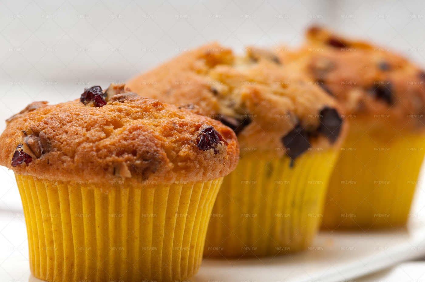 Chocolate And Raisin Muffins: Stock Photos