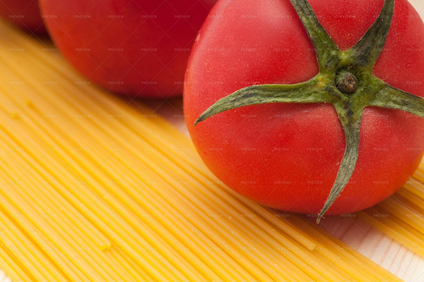 Fresh Tomatoes And Spaghetti Pasta: Stock Photos