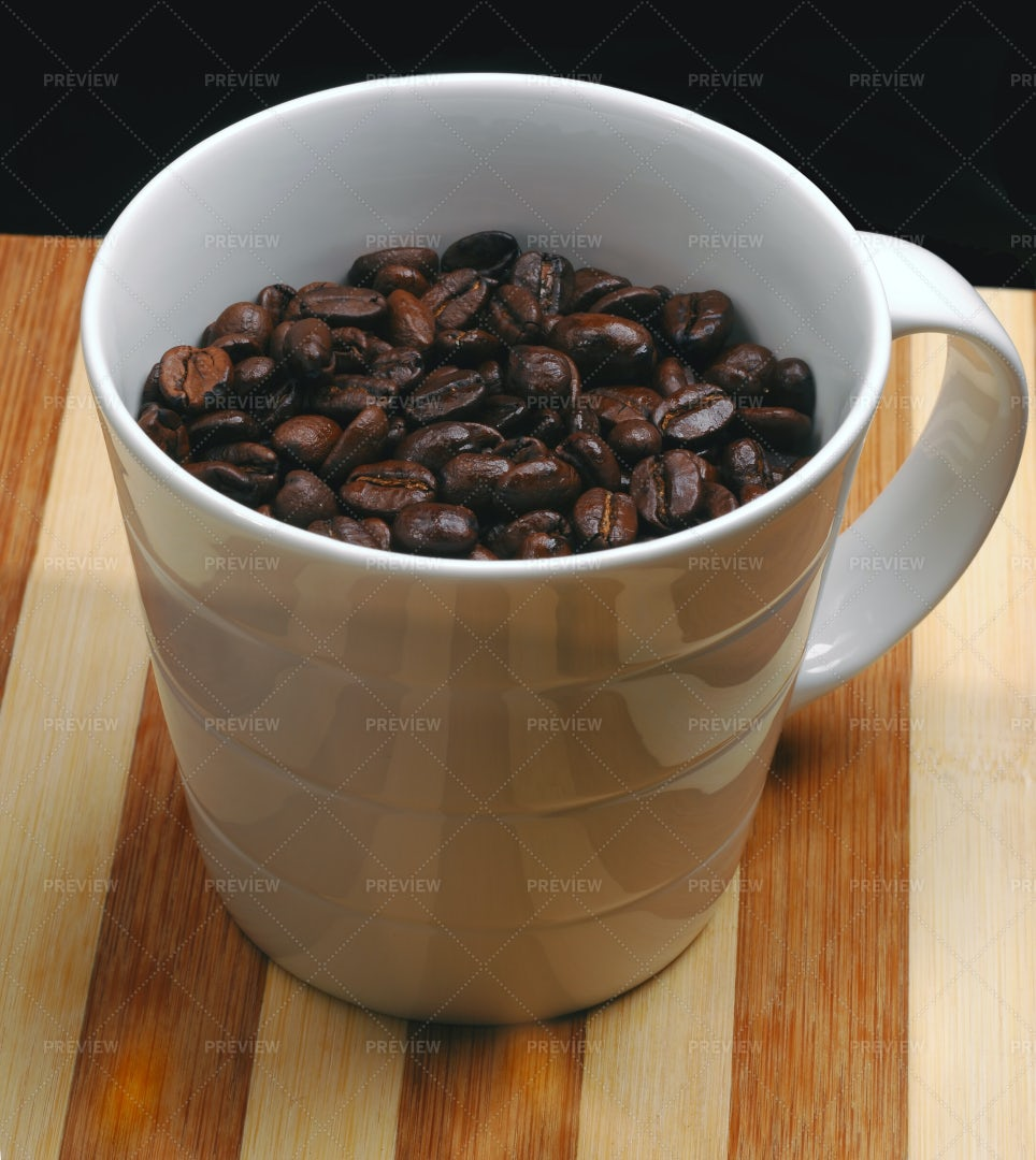 Coffee Beans On Cup: Stock Photos