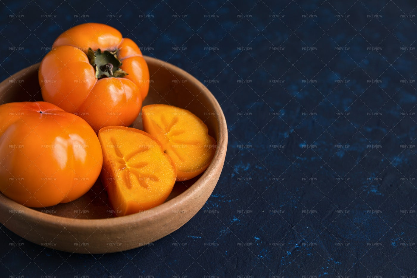 Persimmon In Clay Plate: Stock Photos