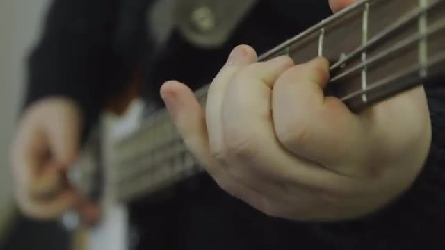 Playing The Bass Guitar: Stock Video