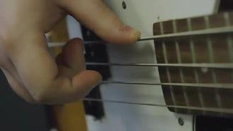 Plucking The Bass Guitar: Stock Video
