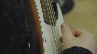 Close-up Of Hand Playing Guitar: Stock Video