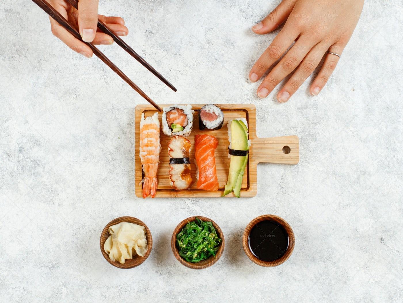 Eating Sushi Rolls: Stock Photos