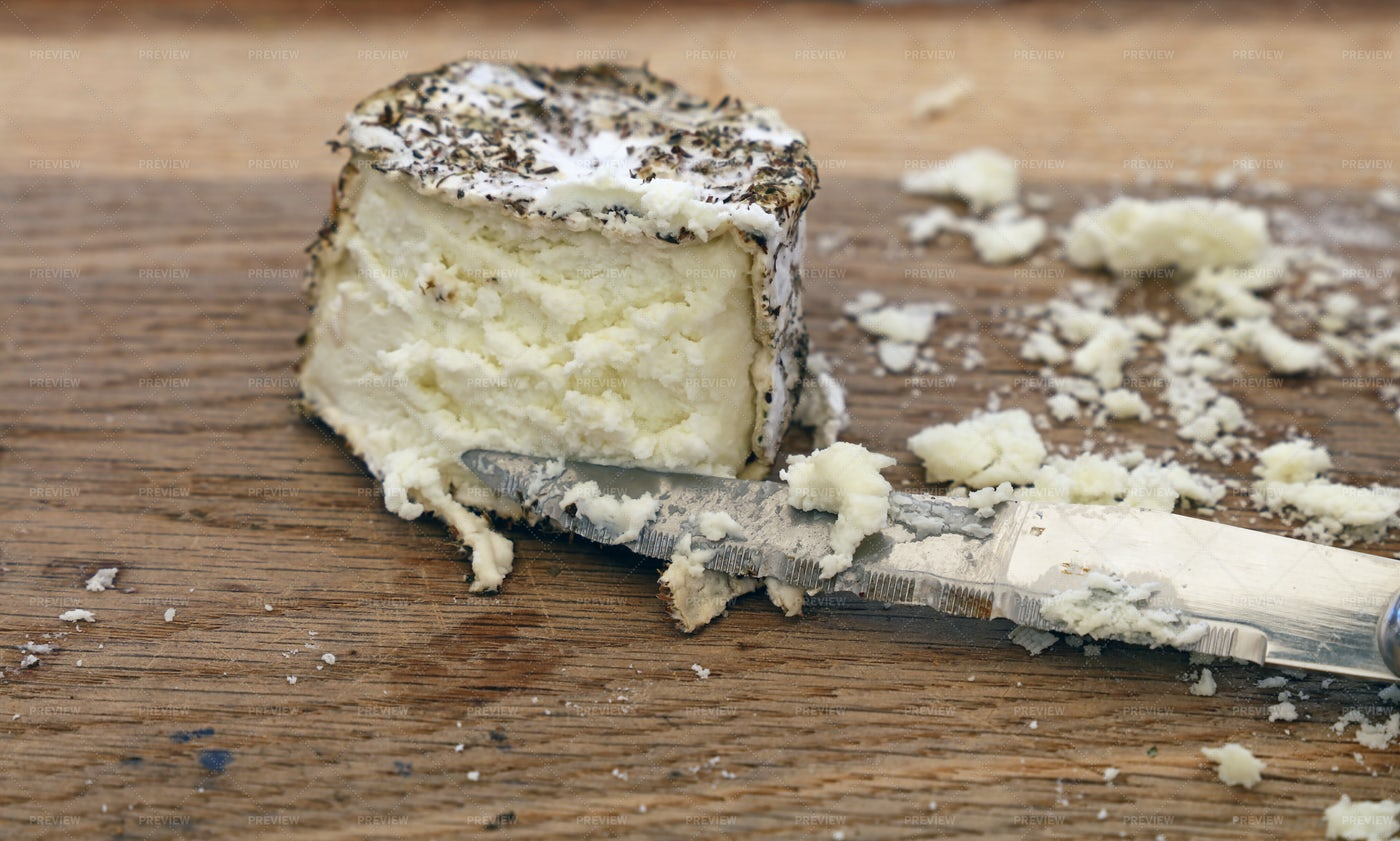 Cutting Goat Cheese: Stock Photos