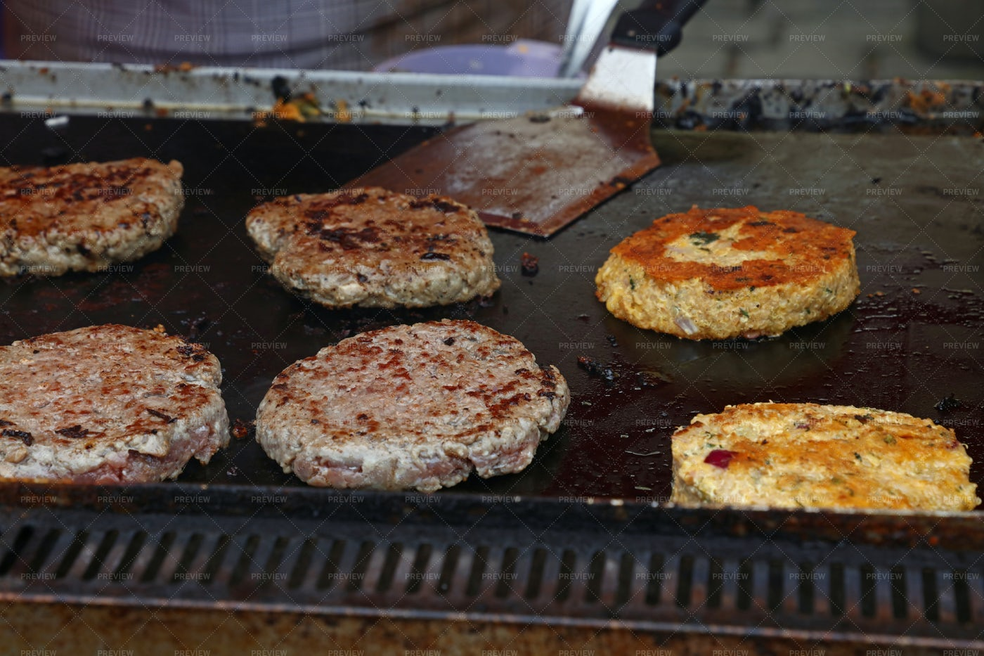Grilling Beef Burgers: Stock Photos