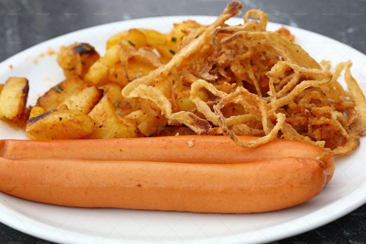 Sausages With Roasted Potatos: Stock Photos
