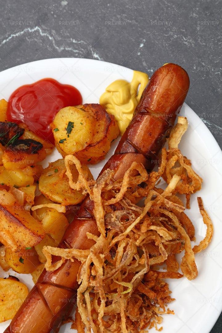 Sausage With Roasted Potato: Stock Photos