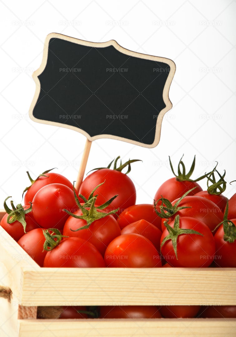 Tomatoes With A Price Sign: Stock Photos