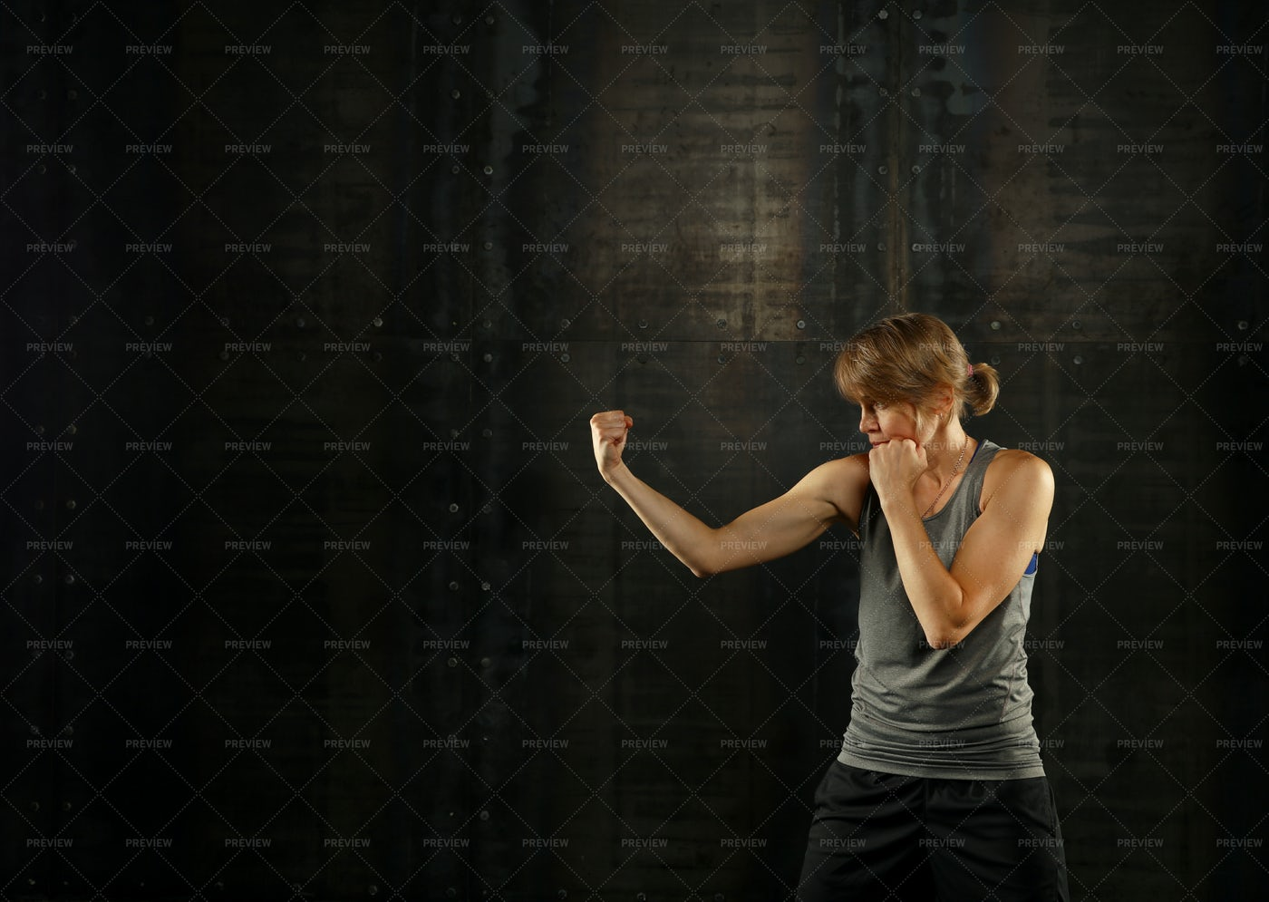 Athletic Woman Shadow Boxing: Stock Photos