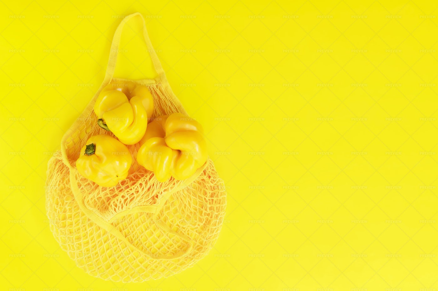 Yellow Peppers In Bag: Stock Photos
