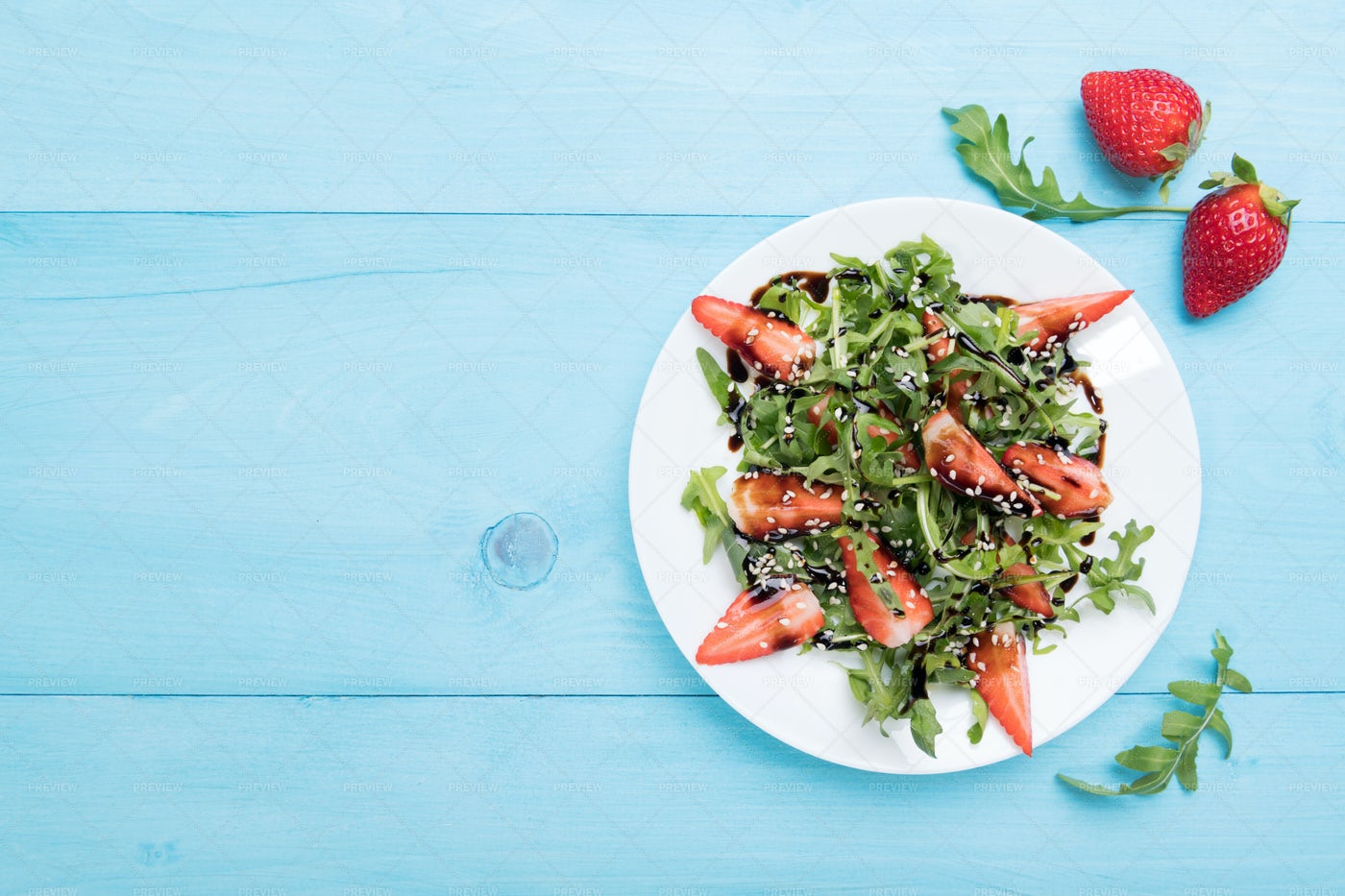 Arugula And Strawberry Plate: Stock Photos