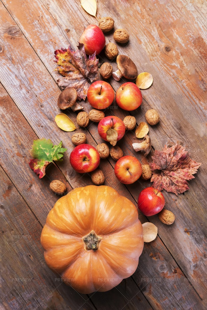 Orange Pumpkin With Fall Harvest Food: Stock Photos