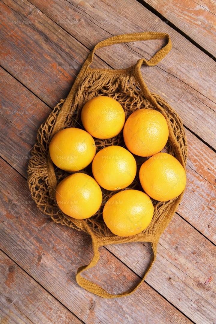 Oranges In String Bag: Stock Photos