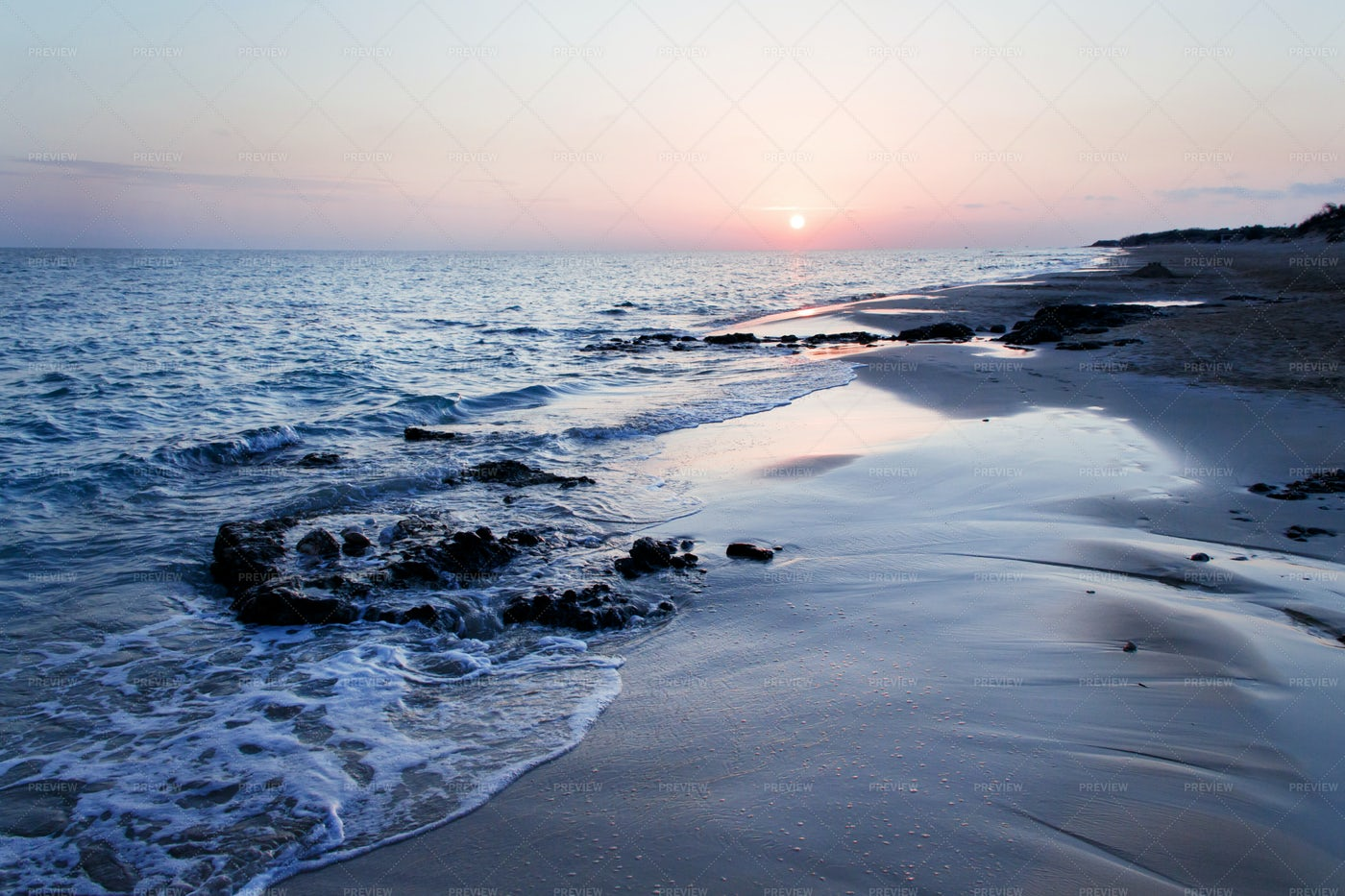 Sunset On Pescoluse Beach In Italy: Stock Photos