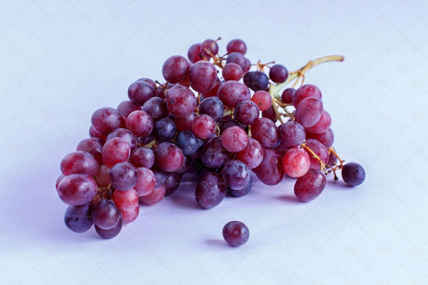 Grapes On A Light Purple Background: Stock Photos
