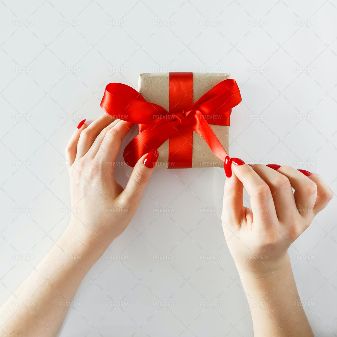 Gift With A Red Ribbon: Stock Photos
