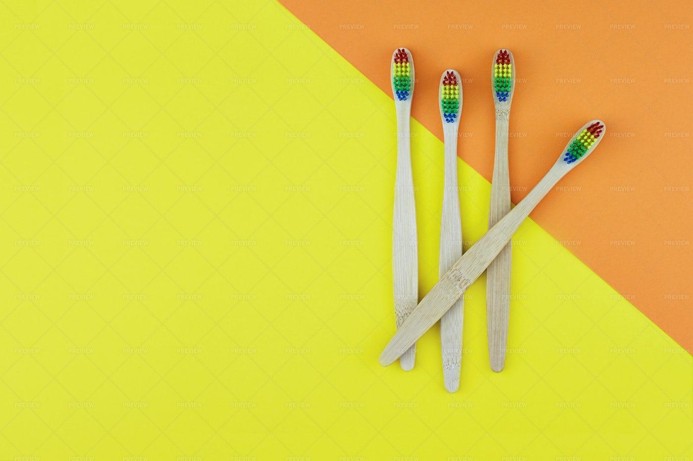 Four  Bamboo Toothbrushes: Stock Photos