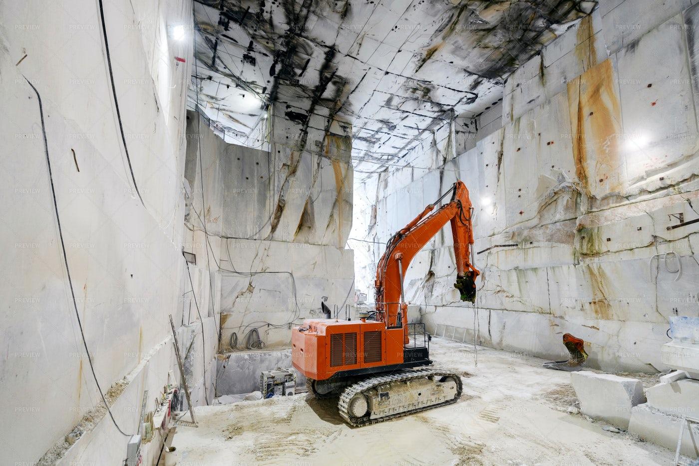 Excavator Inside Marble Quarry: Stock Photos