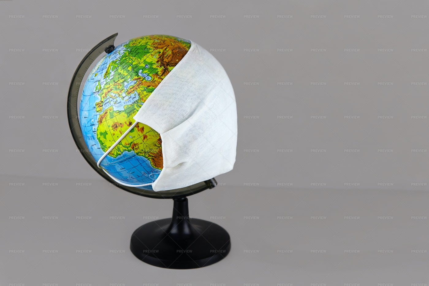 Globe With Medical Mask: Stock Photos