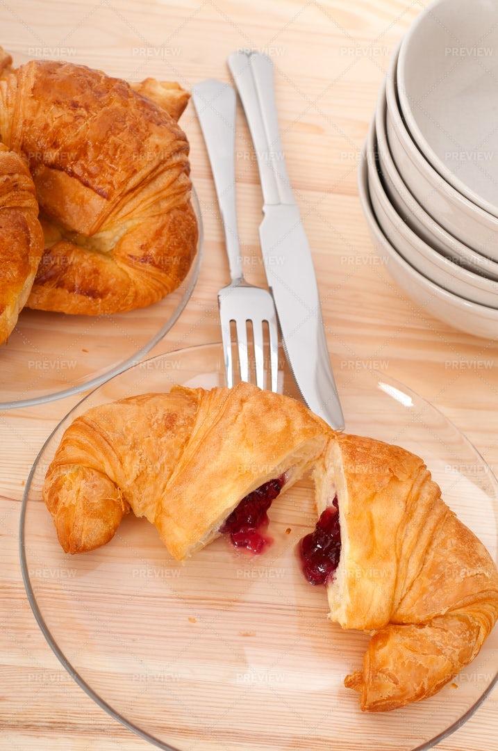 Strawberry Jam Filled Croissant: Stock Photos
