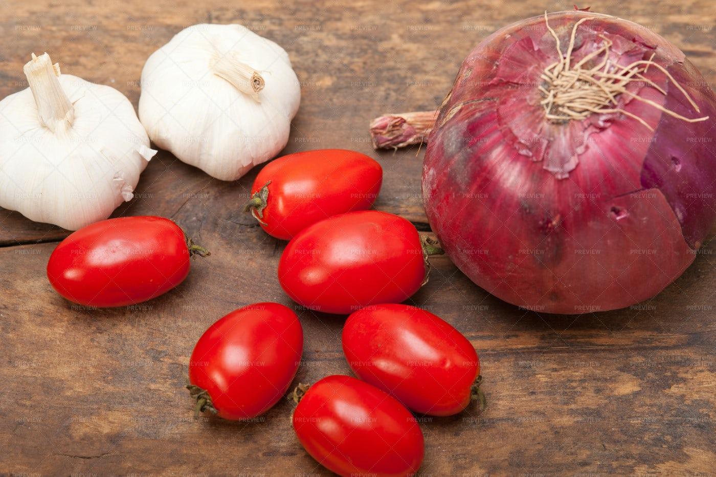 Onion, Garlic And Tomatoes: Stock Photos