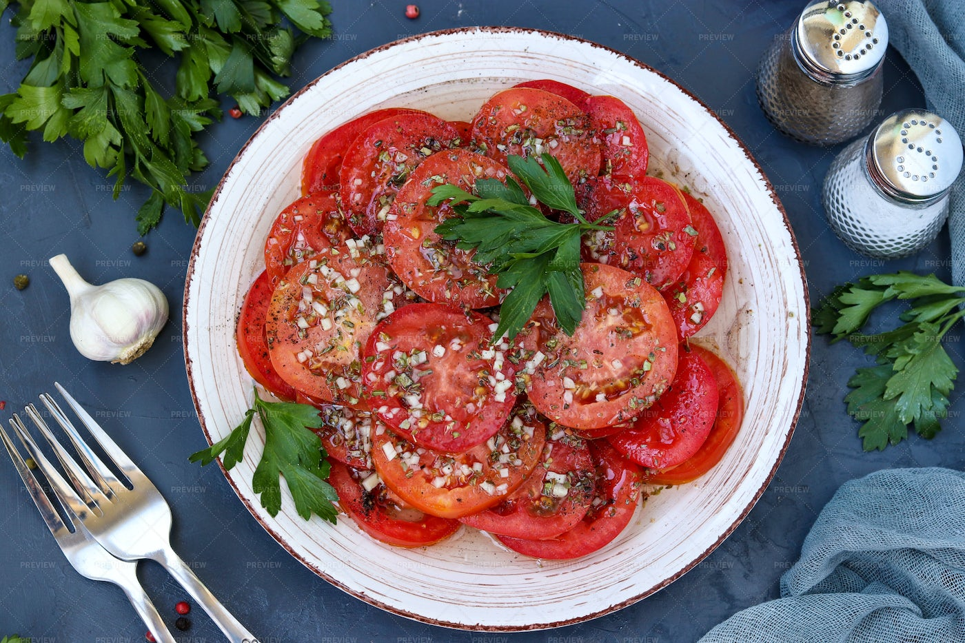 Sliced Tomatoes With Garlic: Stock Photos