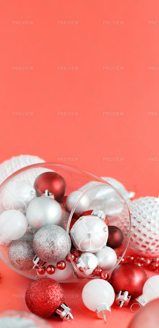 White And Red Baubles In A Wine Glass: Stock Photos