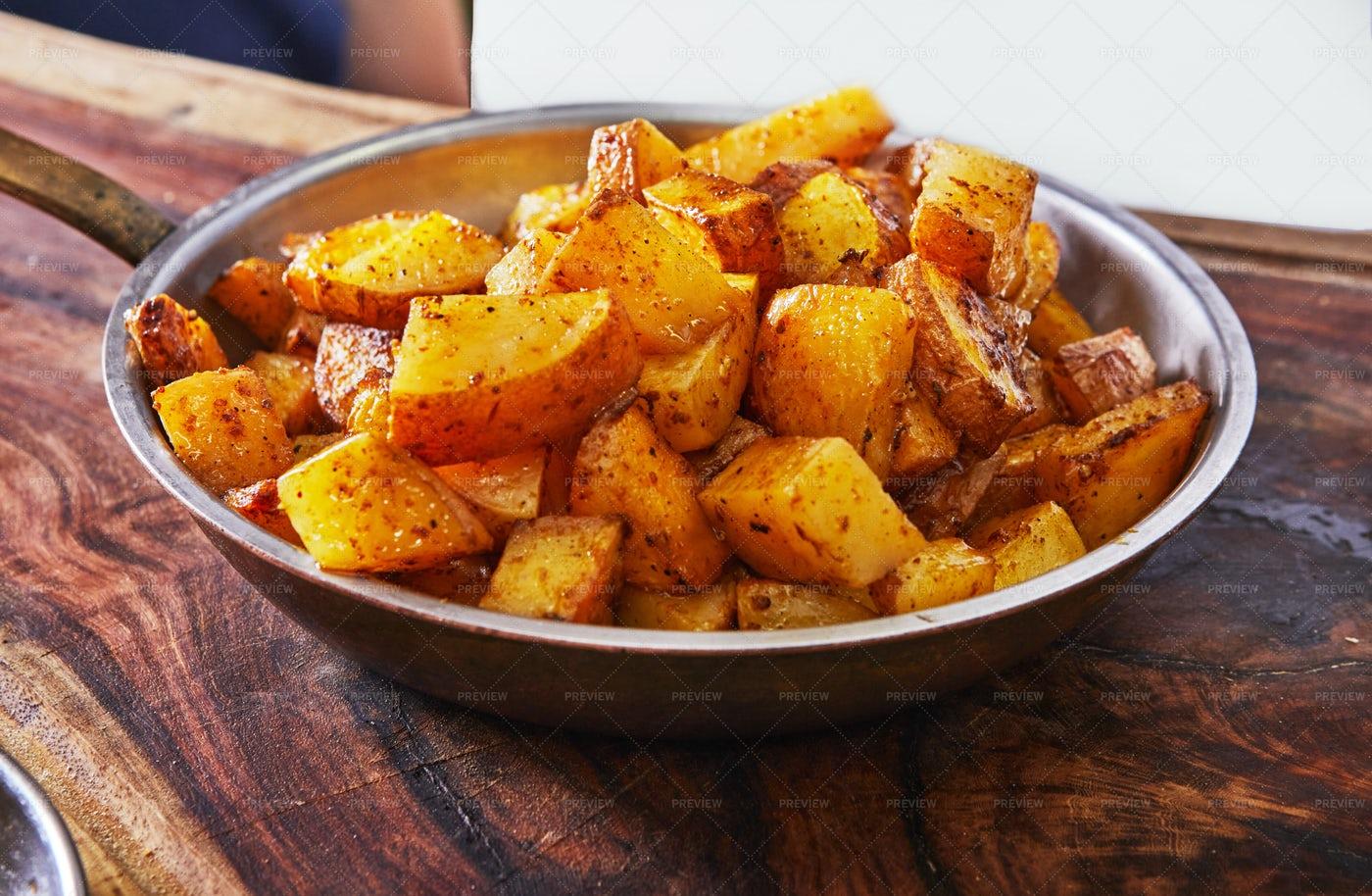Pan Of Golden Potatoes: Stock Photos