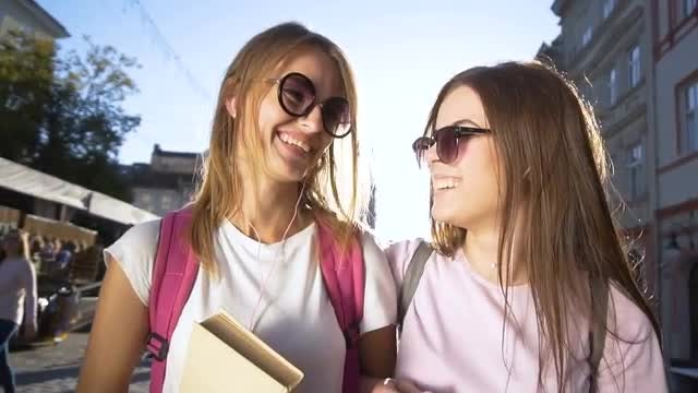 Two Young Girls Walking Happily: Stock Video