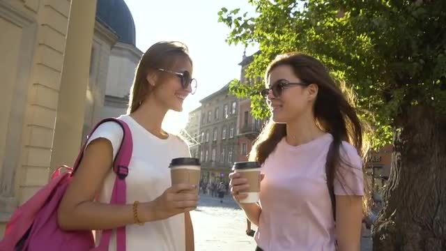 Girls Having Coffee In Street: Stock Video