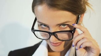 Businesswoman Looking Over The Glasses: Stock Video
