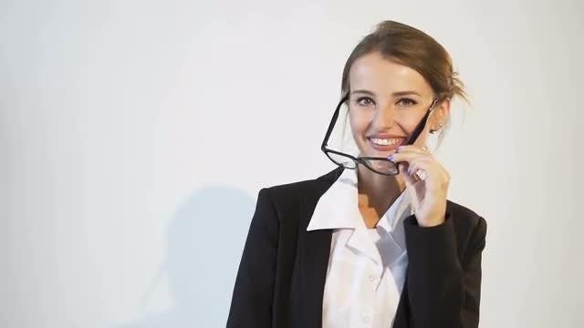 Businesswoman Taking Off Eyeglasses: Stock Video