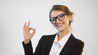 Happy Businesswoman Making Okay Sign: Stock Video