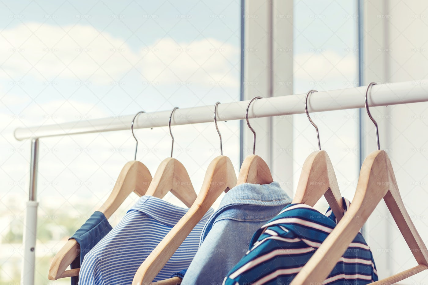 Clothes Hanging On Rack: Stock Photos