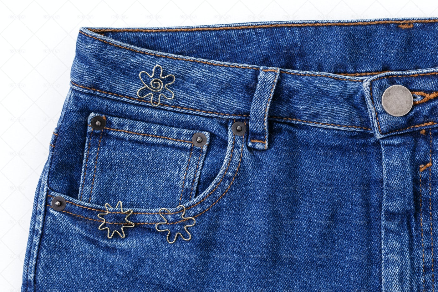 Metallic Clips On Blue Jeans: Stock Photos
