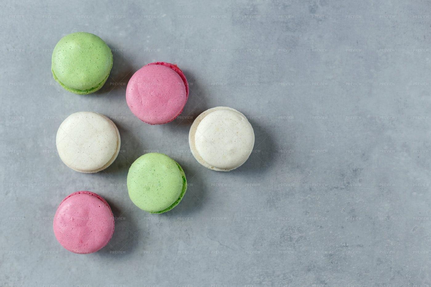 Six Macarons On Gray: Stock Photos