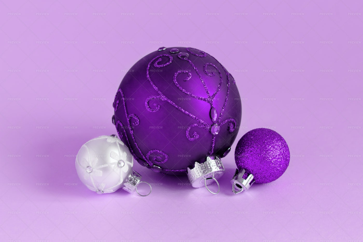 Purple And Silver Baubles: Stock Photos