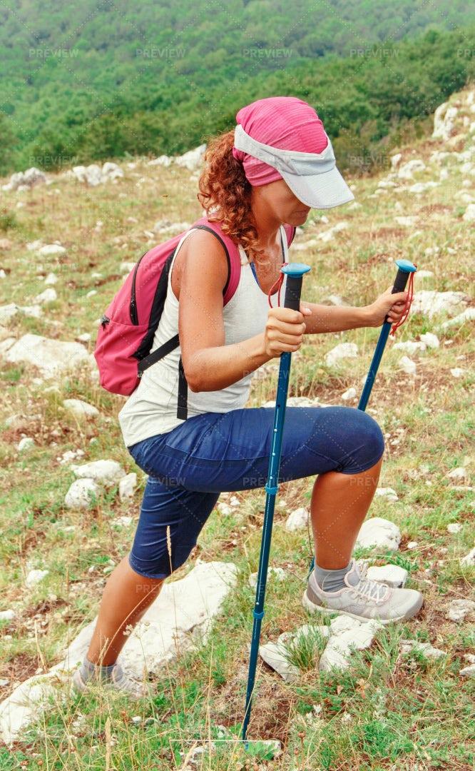 Woman Hiking With Sticks: Stock Photos