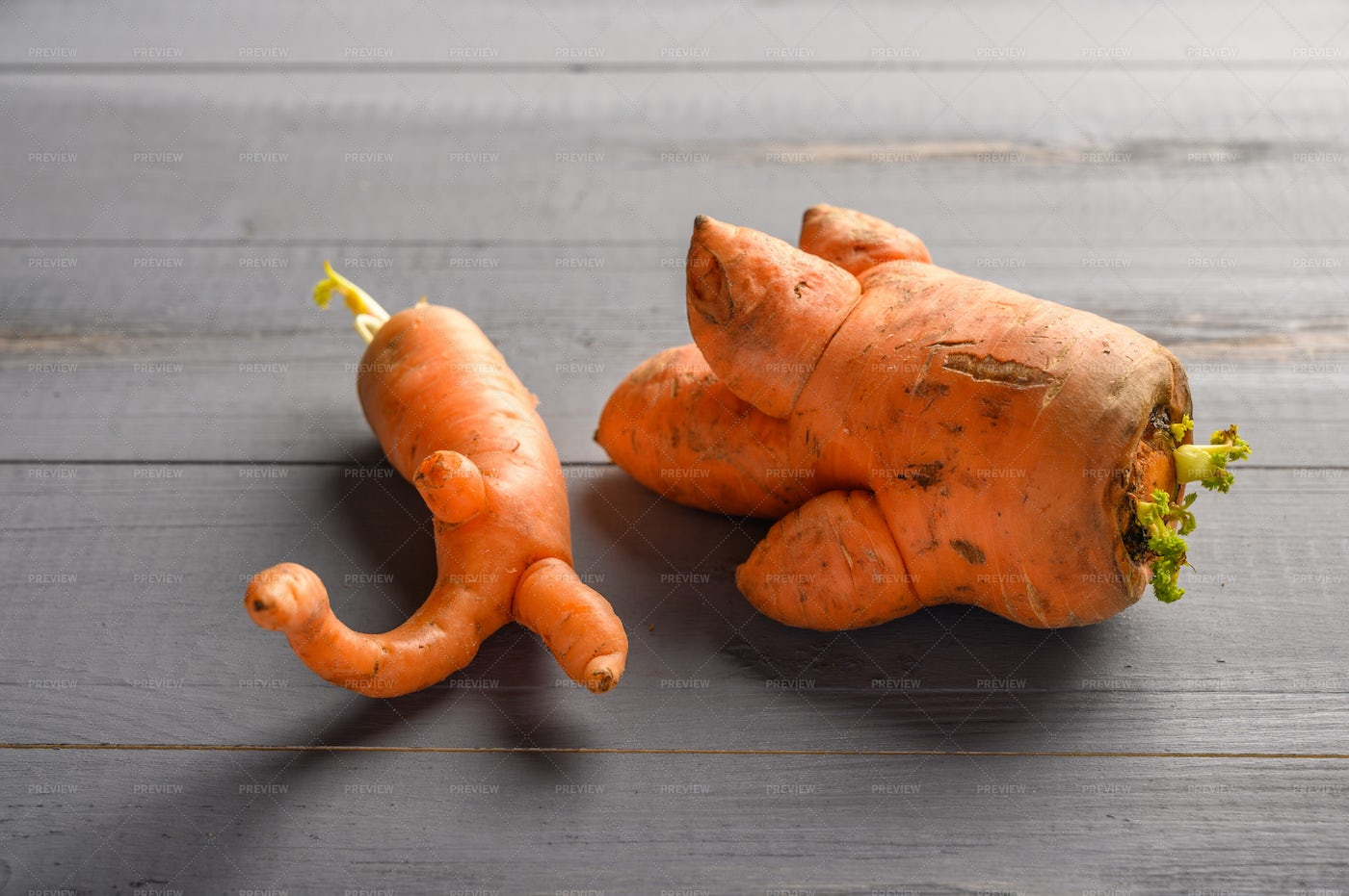 Ugly Carrots On Table: Stock Photos