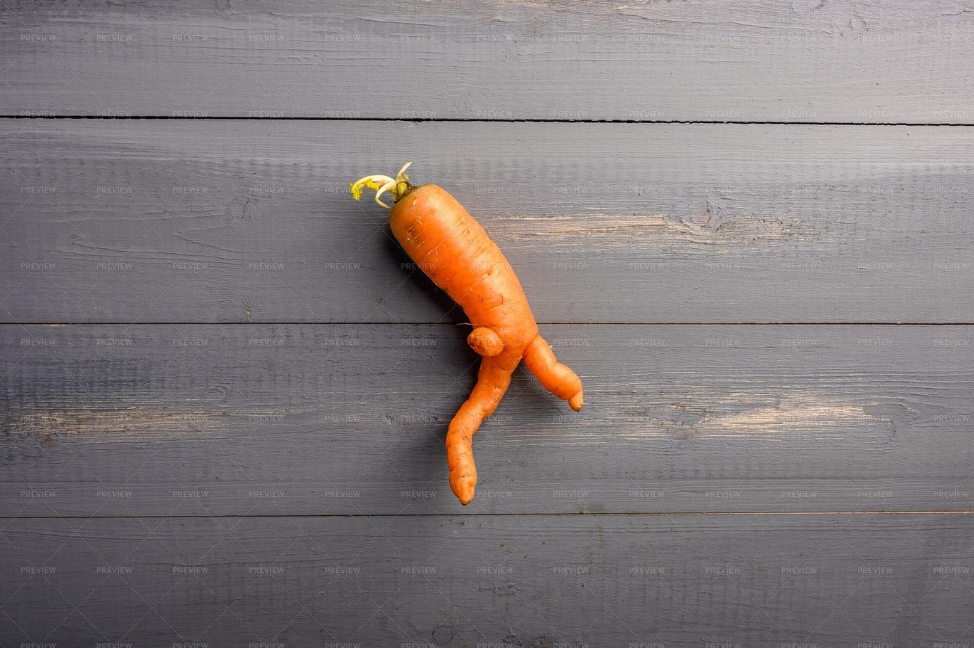 Ugly Carrot Concept: Stock Photos